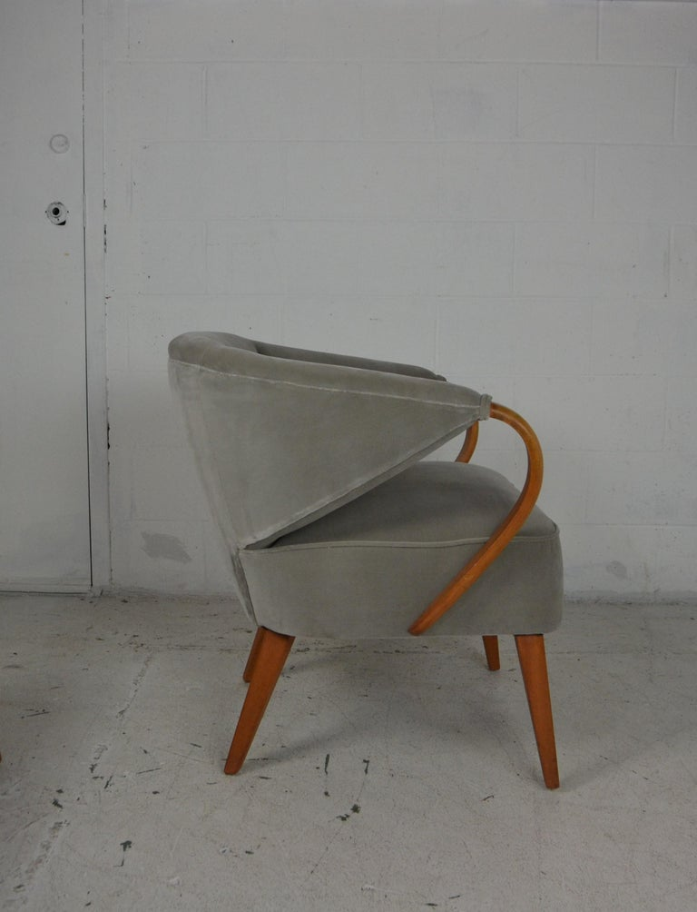 Pair of midcentury armchairs. Upholstered in light gray velvet fabric.