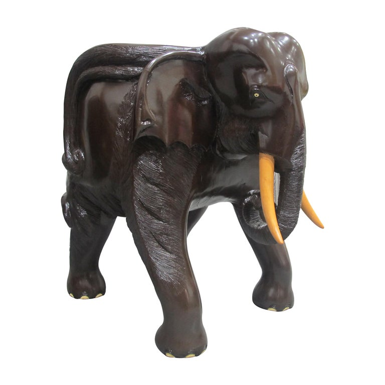 A stunning pair of chairs which have been hand carved as elephants. Each chair is hand carved from a single piece of hardwood timber with a dug-out formed seat. These exceptional chairs are very comfortable and beautifully detailed with painted eyes