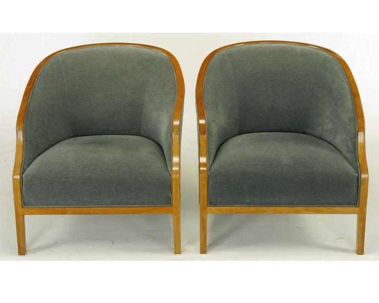 Striking pair of club chairs designed by Ward Bennett for Brickel Associates. Featuring a graceful curving banded frame, with a light oak finish and professionally upholstered in velvet.  Quite simply, there is no area of art and design in which