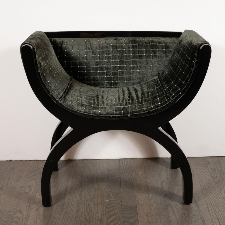 This stunning pair of Mid-Century Modern benches were realized in the French, circa 1950. They feature stylized black lacquer demilune seats whose form is reiterated in the curvilinear legs. The seats, sides and backs have been newly reupholstered