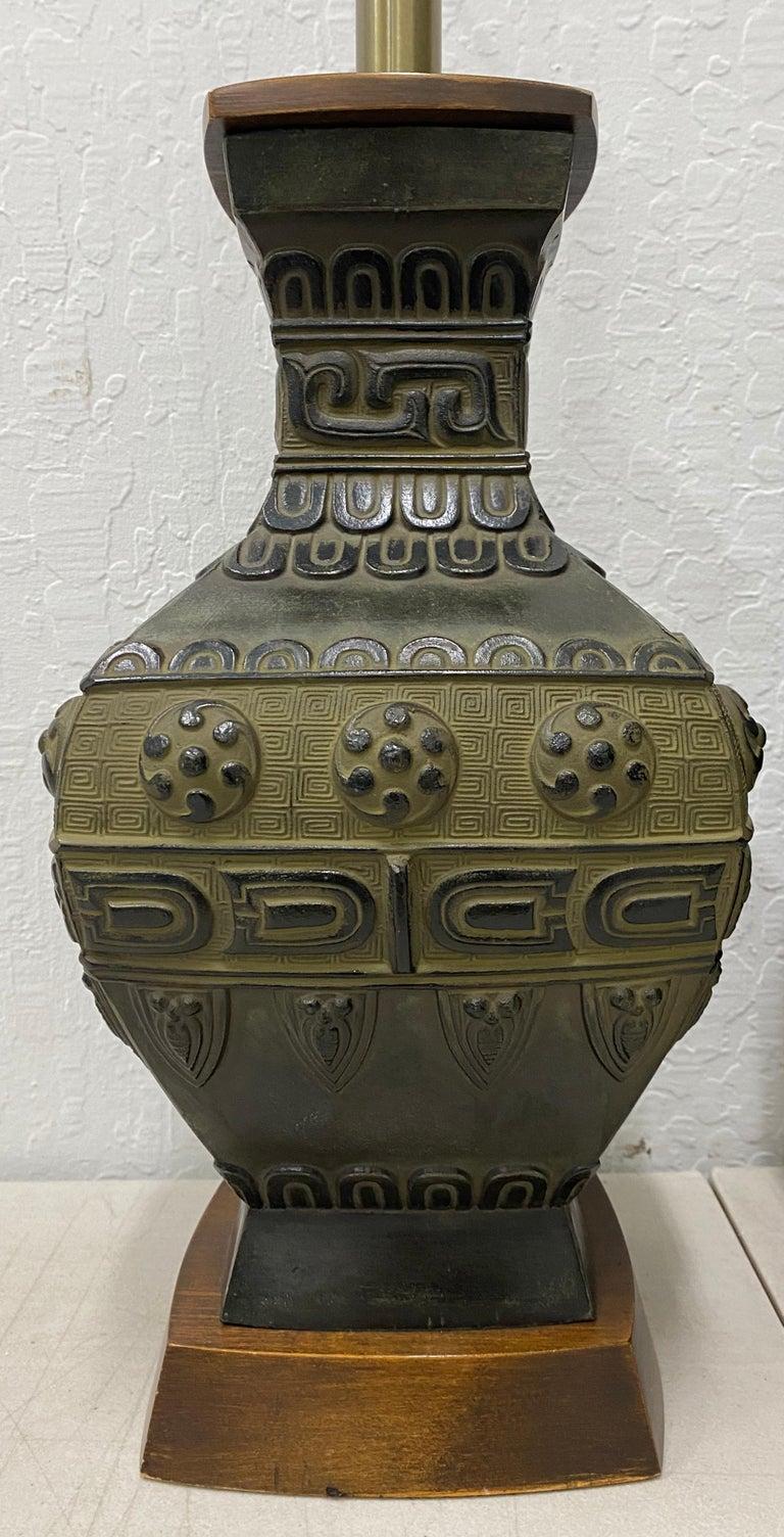 Pair of midcentury bronze urn lamps by Marbro, circa 1950  Measures: 5.5