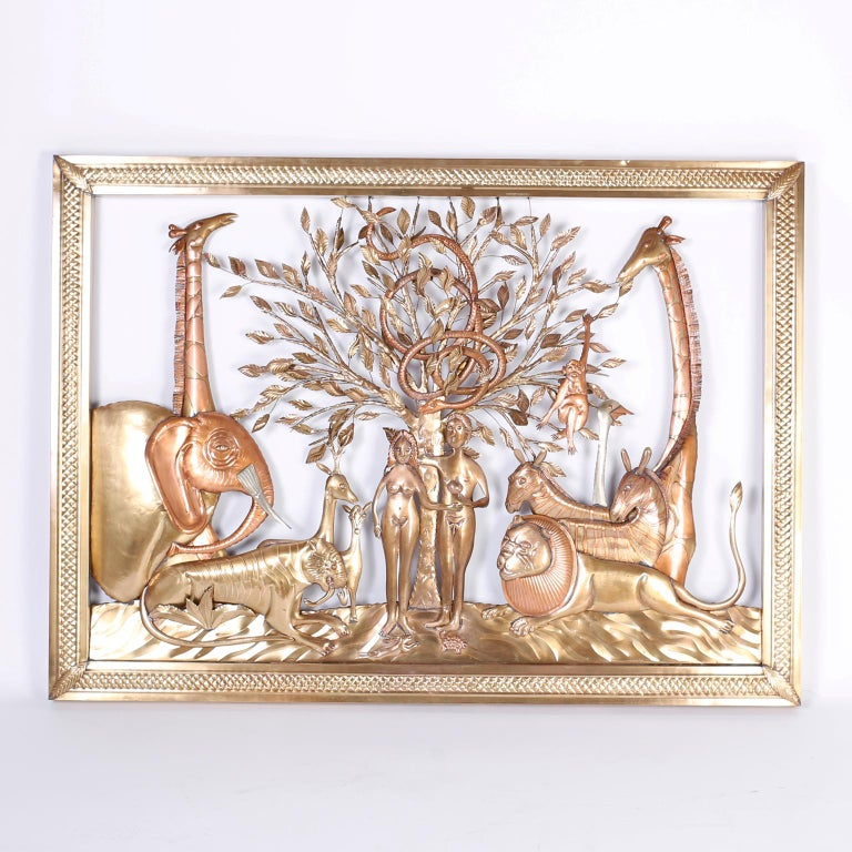 Striking pair of midcentury wall sculptures ambitiously crafted in brass and copper with a folky naive style depicting a cast of characters including Adam and Eve and the apple, big cats, giraffes, a monkey, an elephant, and of course, the serpent.