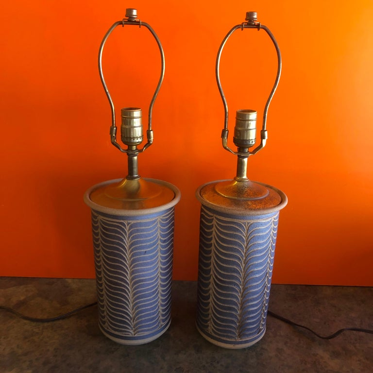 A gorgeous pair of midcentury California studio pottery stoneware table lamps, circa 1960s. The lamps, in the style of David Cressey & Robert Maxwell, measure 6.5