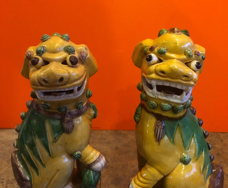 Chinese Pair of Midcentury Ceramic Foo Dogs or Bookends For Sale