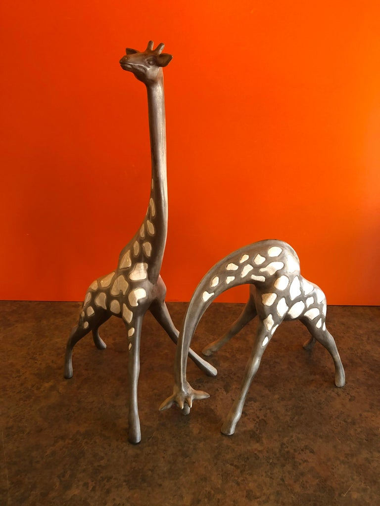 Wonderful and hard to find pair of midcentury ceramic giraffes by McFarlin Freeman Pottery, circa 1960s. The pair are well detailed and super delicate, the large giraffe measures 8.25