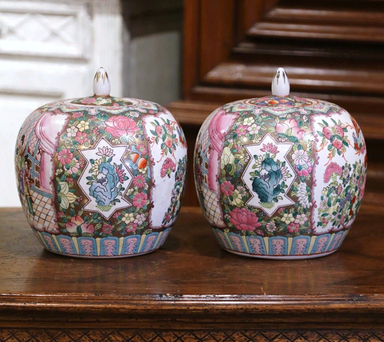 Decorate a console or mantle with this colorful pair of colorful antique melon jars. Created in China, circa 1880, each enameled vase is decorated with foliate motifs, reserves depicting birds, figural scene, and further embellished with Famille