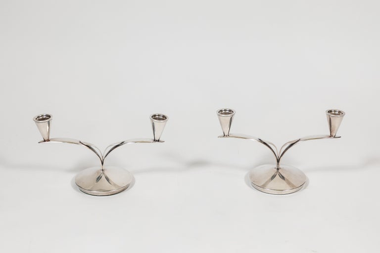 Pair of midcentury Danish 2-arm silver plated candle holders.