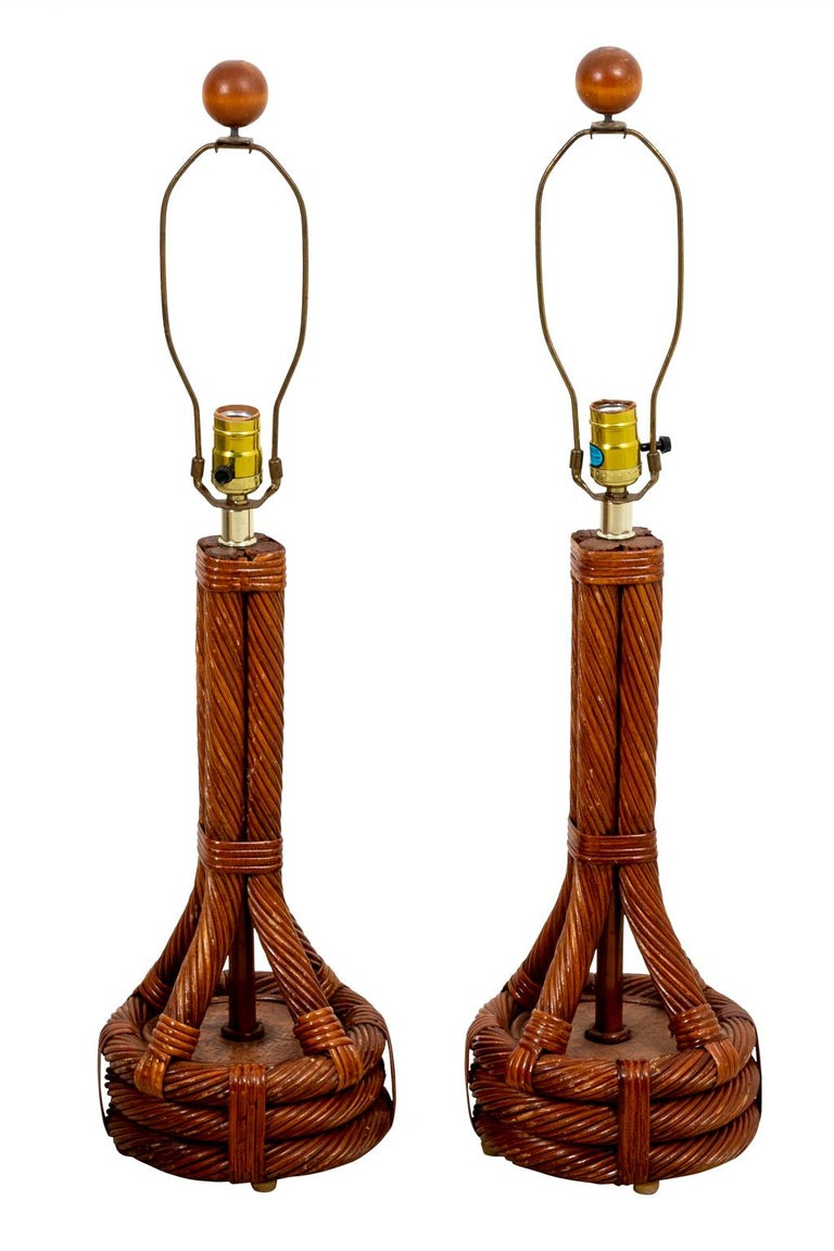 Circa 1960s pair of Mid-Century Danish modern table lamps in brass and teakwood. Made in Denmark. Shades not included. Please note of wear consistent with age including slight discoloration. There is also minor finish loss to the wood and minor