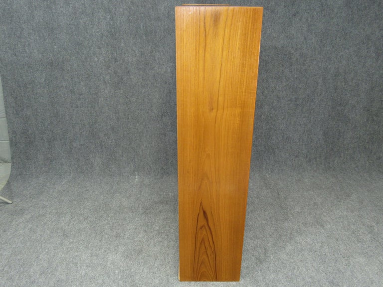 Set of two matching 1960s Mid-Century Modern cabinets with plinth base Danish modern Poul Hundevad for HU teak. Cabinets have 2 doors that glide smoothly and are fronted with sculpted pulls. Well crafted and executed pieces. Marked with HU paper