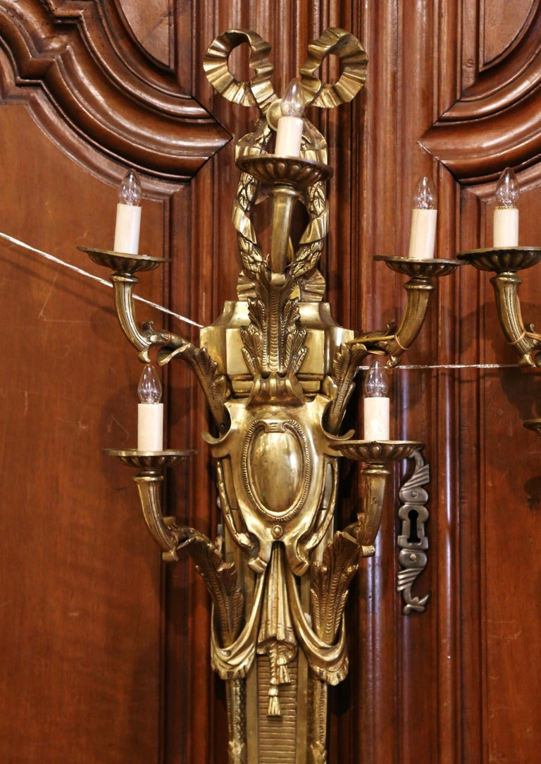 Pair of Mid-Century French Louis XVI Bronze Dore Five-Light Wall Sconces In Excellent Condition For Sale In Dallas, TX