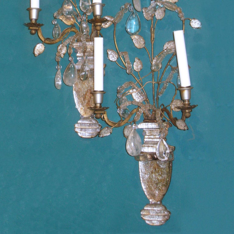 Pair of midcentury glass, rock crystal and gilt metal sconces attributed to Baguès.