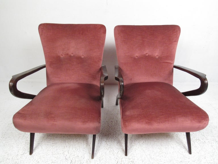 Stylish and sculptural open armchairs by renowned Italian artist Paolo Buffa. Sleek timeless design, perfect for that midcentury home or office environment. Please confirm item location (NY or NJ) with dealer.