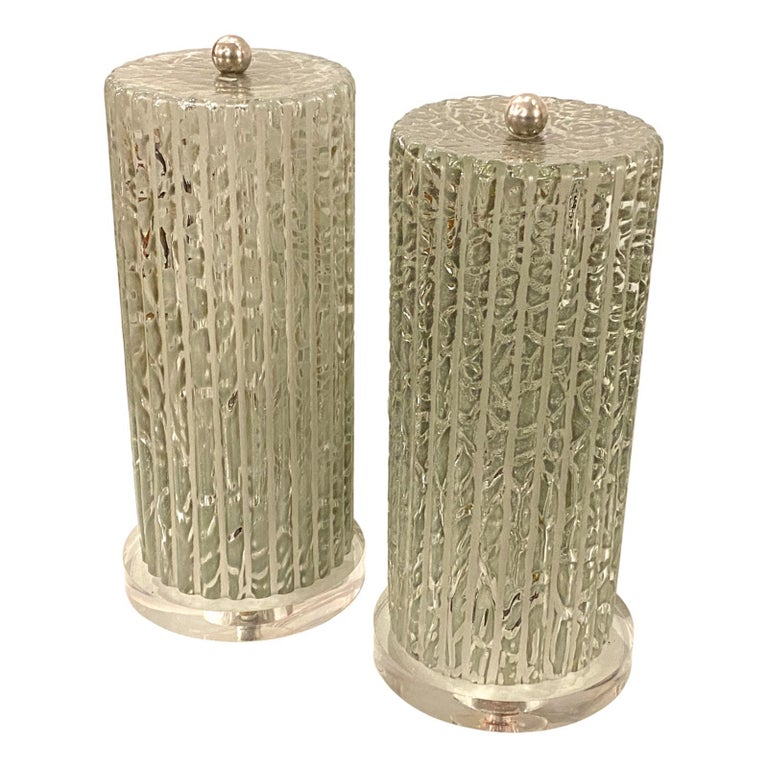 Pair of circa 1960s Italian enclosed hurricane molded glass lamps with interior light, Lucite bases and nickel-plated finial.  Measurements: Height 15.5