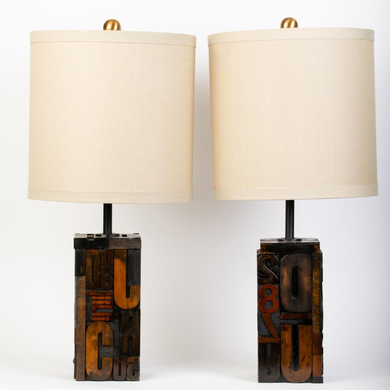 These special bespoke vintage lamps were made from antique wooden letterpress alphabet and number blocks. They have been rewired and restored with new sockets, harp and shades (two styles available/See pics).