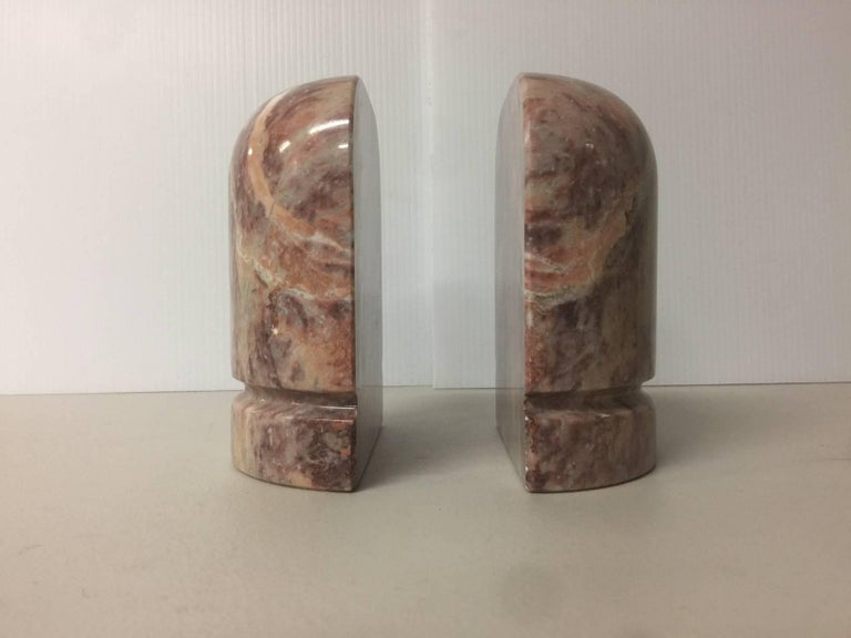 Large and substantial pair of highly polished brown/tan/rust marble bookends, circa 1970s.