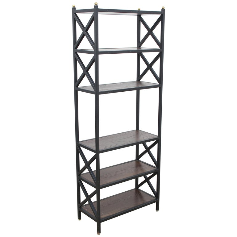 Pair of Mid-Century Modern architectural X-form bookcases or étagères. These bookcases are architectural or Industrial style, with Classic midcentury lines, circa 1970s. Heavy duty and heavy frames with be repainted satin black, brass balls