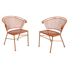 Pair of Mid-Century Modern Atomic Orange Outdoor Metal Curved Back Chairs