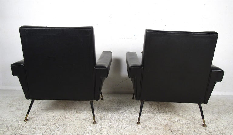 Metal Pair of Mid-Century Modern Black Vinyl Lounge Chairs For Sale
