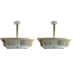 Pair of Mid-Century Modern Brass and Glass Pendant Lights