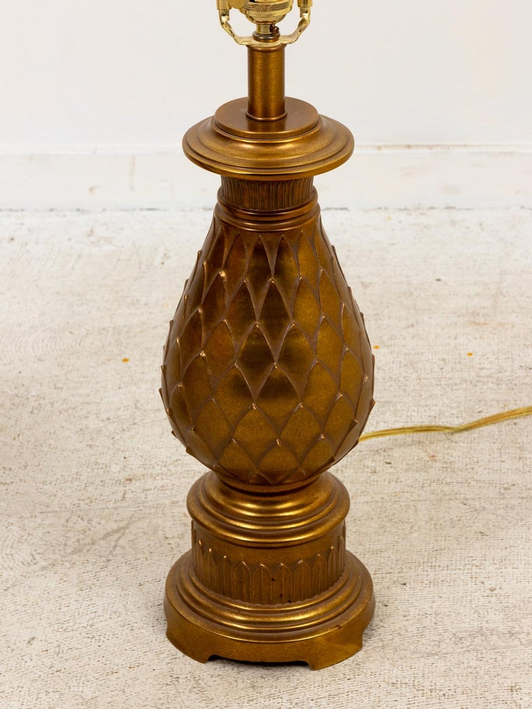 Circa 1980s pair of Mid-Century Modern style brass table lamps in the shape of stylized pineapple designs. Shades not included. Please note of wear consistent with age. Made in the United States.