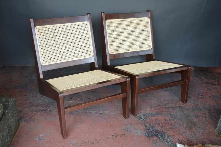 Pair of Cane Chairs in the Style of Pierre Jeanneret.