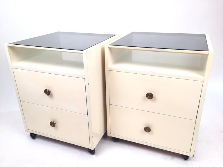 A beautiful pair of Carlo de Carli nightstands, edited by Sormani in the 1960s.Lacquered wood, glass top and brass.