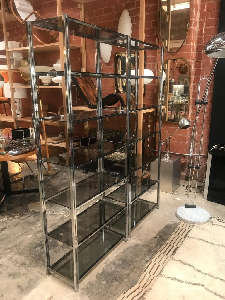 Pair of Mid-Century Modern chrome étagère with six glass shelves.