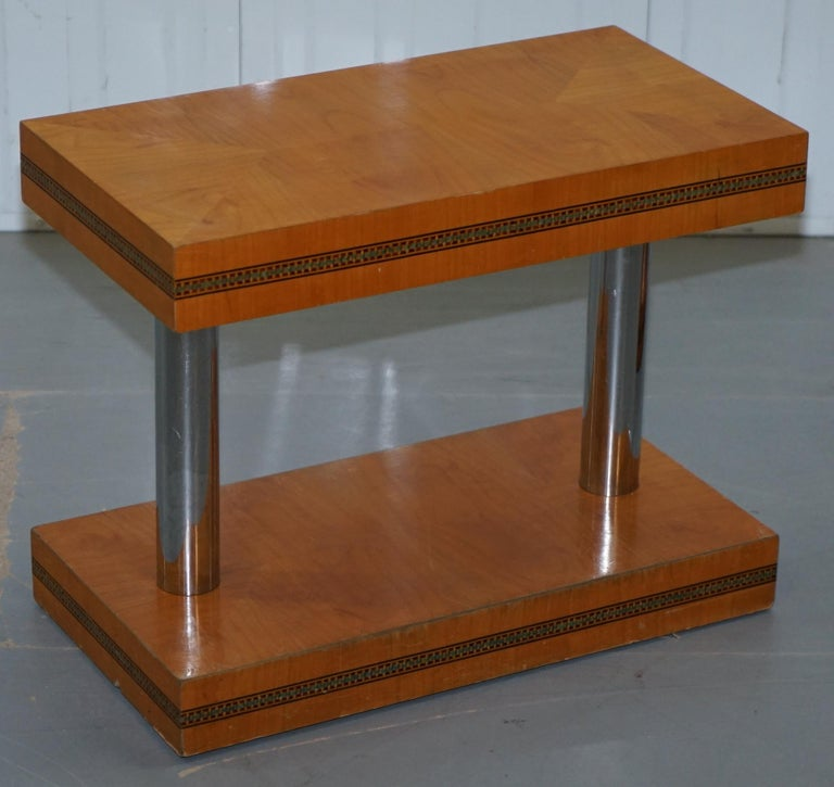 We are delighted to offer for sale this lovely pair of genuine mid-century modern Satinwood side tables with Chrome plated pillars  A very good looking and well made pair of side tables, they are quite large, if seated next to a sofa or armchair