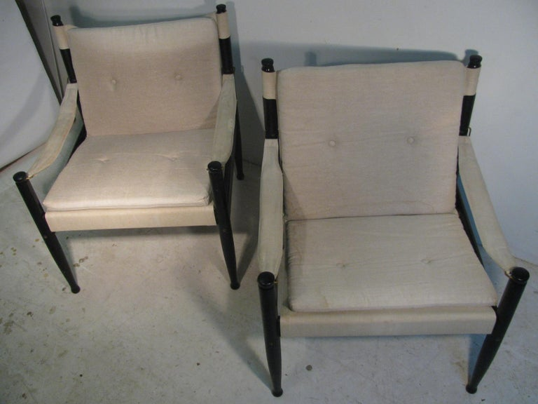 Wonderful pair of safari lounge chairs by Erik Worts for Niels Eilersen. Black Enameled with canvas upholstery, chairs are in very good condition with some water stains on the canvas.