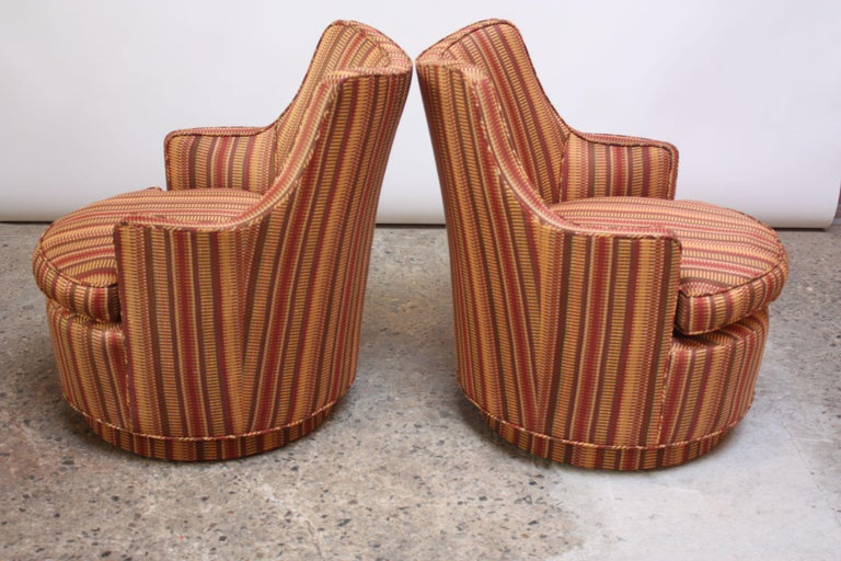 Upholstery Pair of Mid-Century Modern Diminutive Swivel Chairs For Sale