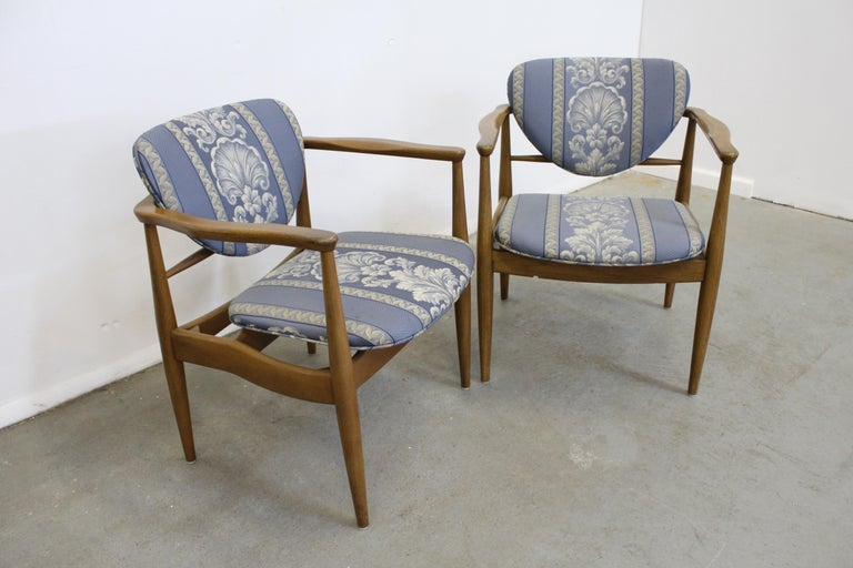Pair of Mid-Century Danish Modern John Stuart Finn Juhl walnut armchairs   Offered is a pair of Mid-Century Modern arm chairs attributed to Finn Juhl. Look to be walnut and have been reupholstered by their previous owner. In good, structurally