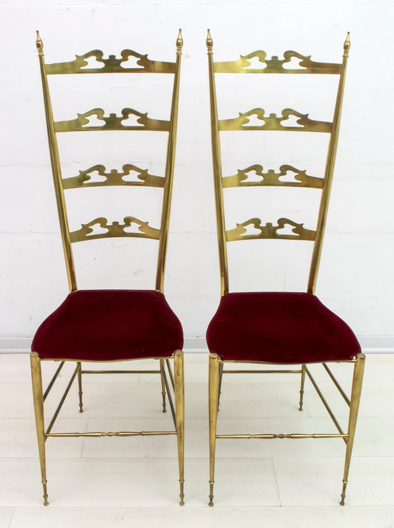 Pair of Chiavari chairs, in solid brass, model with high back, 1950s production. Brass with original patina, we can polish it at no additional cost.  Originally designed by Giuseppe Gaetano Descalzi and manufactured from the early 19th century in