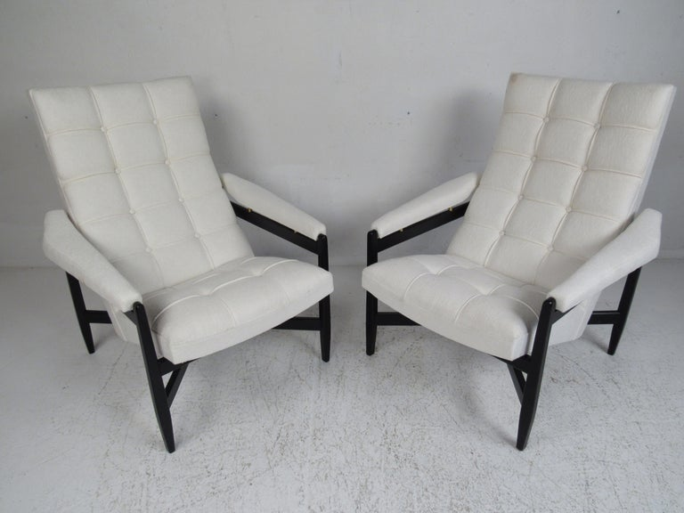 This beautiful pair of vintage modern Italian lounge chairs feature black painted frames with