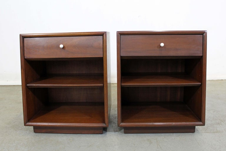 Offered is a pair of walnut nightstands designed by Kipp Stewart for Drexel