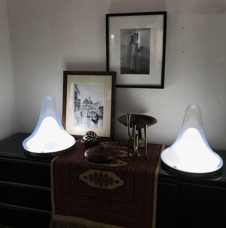 Beautiful pair of Mid-Century Modern table lamps designed by Carlo Nason for Mazzega, circa 1960. Consists of a small white opaline glass and a larger opalescent one and silver toned hardware. This lamps can be used as a table, ceiling or wall