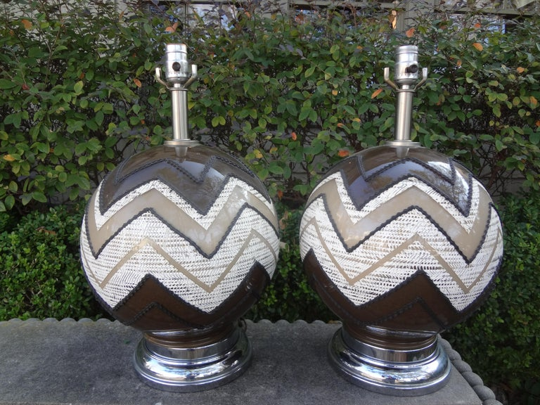 Great pair of Mid-Century Modern glass lamps with a geometric design in neutral tones of brown, white and tan. Our Hollywood Regency/Modernist lamps have been newly wired and are ready for your choice of shades.