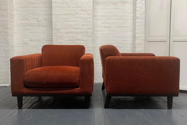 Pair of Mid-Century Modern lounge chairs. Has a wooden black lacquered base and the original upholstery.