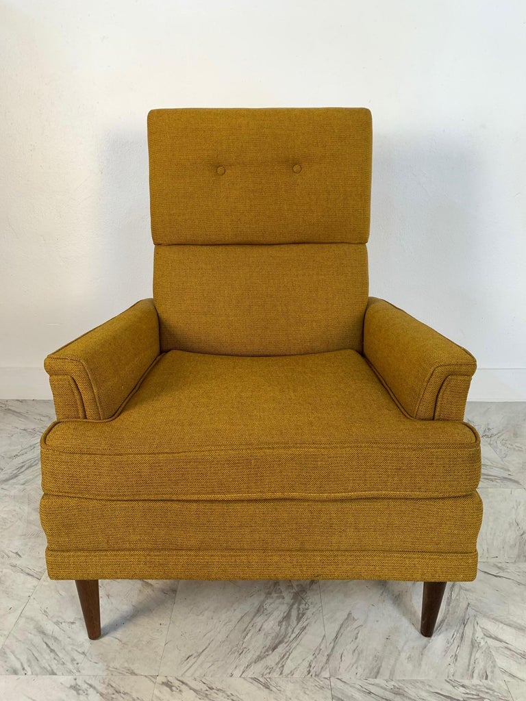 Pair of Mid-Century Modern lounge chairs. Has the original fabric with wood legs.