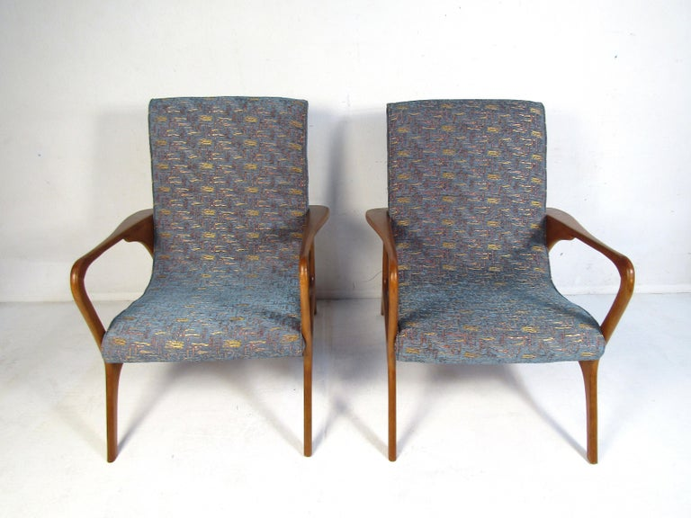 Stylish pair of midcentury lounge chairs. Sculpted frame with an interesting profile. Nice addition to any modern interior. Please confirm item location with dealer (NJ or NY).