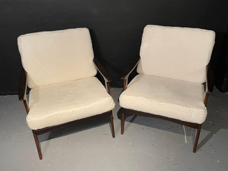 Pair of Mid-Century Modern lounge chairs in the style of Ib Kofod-Larsen having a new Plush Sherpa fabric. This fine pair of custom quality lounge or armchairs in the stylish fashion of Larsen each having a new Sherpa upholstery pair of cushions are
