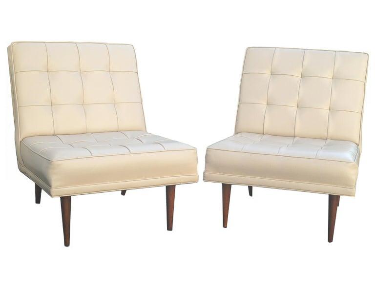 Pair of Mid-Century Modern lounge slipper chairs.