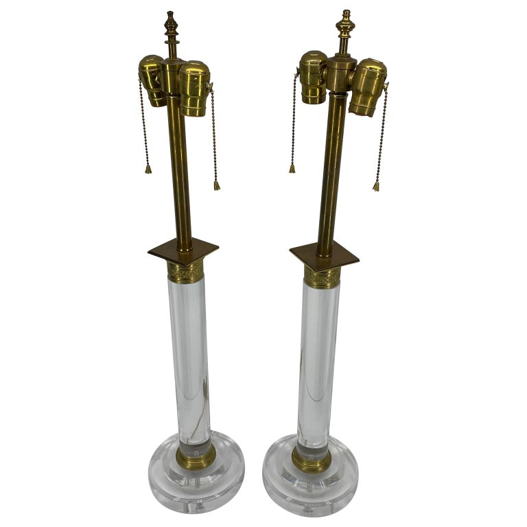 Thick Lucite and gilded bronze table lamps, 20th century, America.