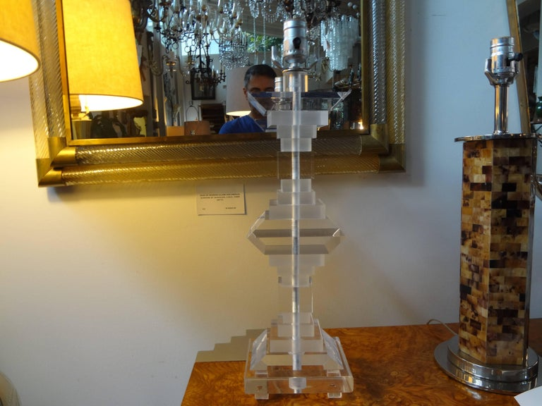 Stunning pair of Art Deco style stacked Lucite or acrylic lamps in the style of Les Prismatiques or Karl Springer. These Hollywood Regency geometric form lamps have been newly wired and date to the 1970s and would work well in many rooms and