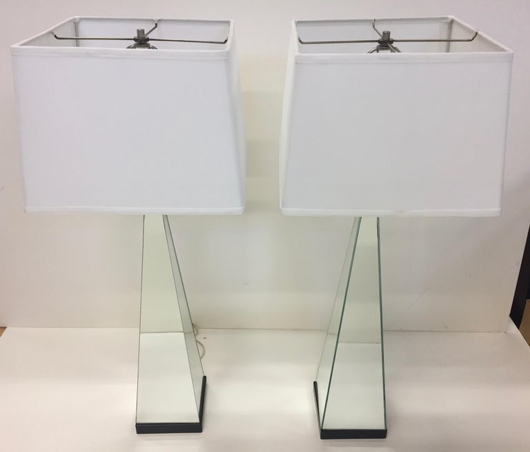 Cool pair of 1960s of mirrored obelisk shaped lamps with black bases.