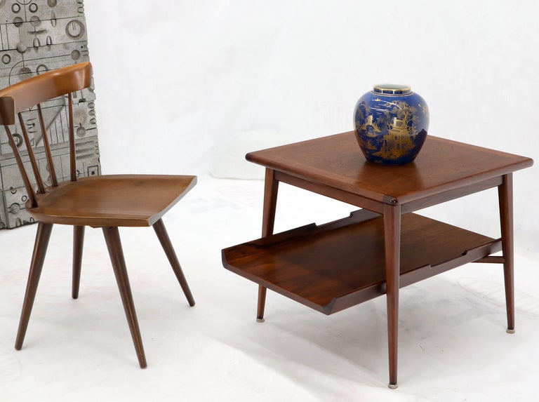Pair of Mid-Century Modern two tier oiled walnut end side tables in stunning condition. Jens Risom Decor match.