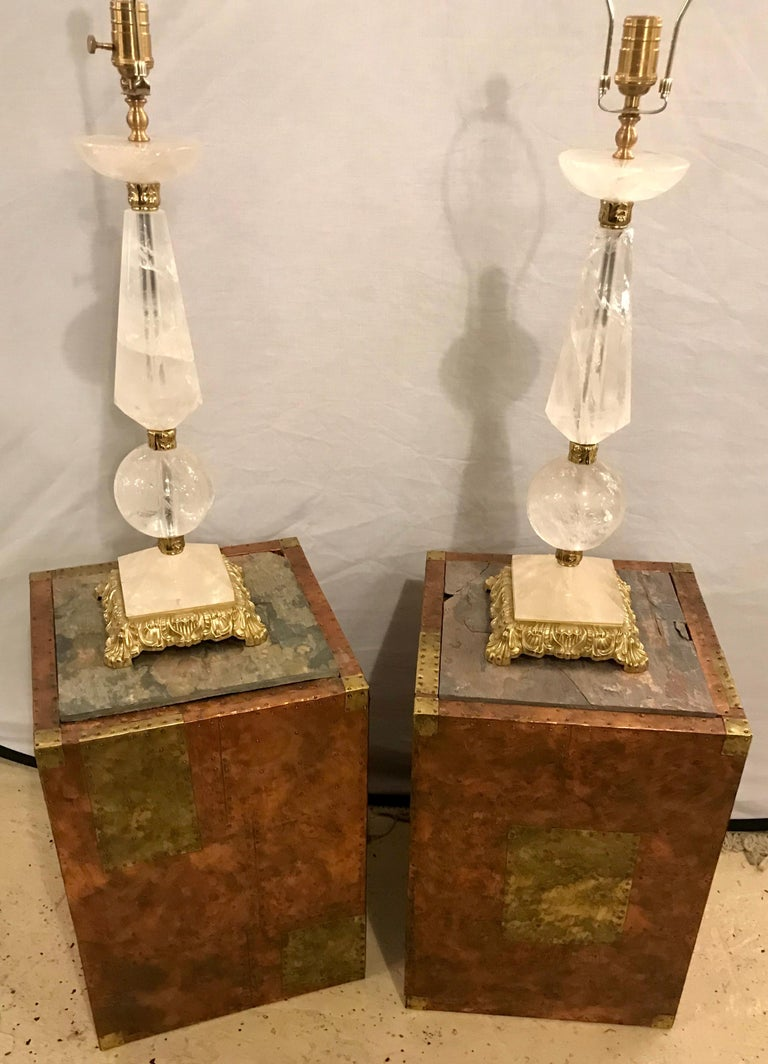 Pair of Paul Evans inspired end tables or pedestals. These fine bronze and metal with cooper hand hammered pedestal or end tables seem to be in the style or fashion of Paul Evans. No markings or signature can be found. The slate tops are worn and