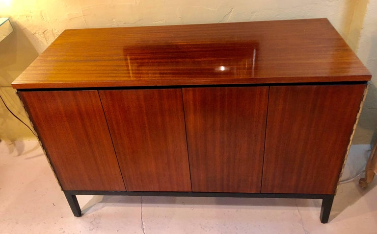 A Fine custom quality pair of Mid-Century Modern Paul McCobb for Calvin chests or nightstands. Fine custom piano hinged doors leading to exceptional fitted and ebonized interiors. Each having multiple drawers. One with full drawers and one with side