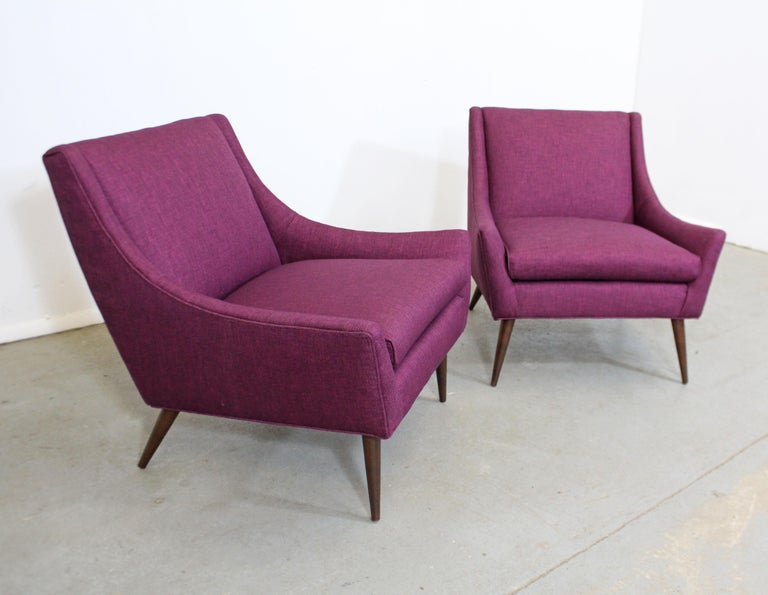 Offered is a pair of gorgeous Mid-Century Modern lounge chairs similar to the style of Paul McCobb. Absolutely incredible lines on these chairs. They have been freshly reupholstered with 'Wild Raspberry' textured fabric. Includes arm and back