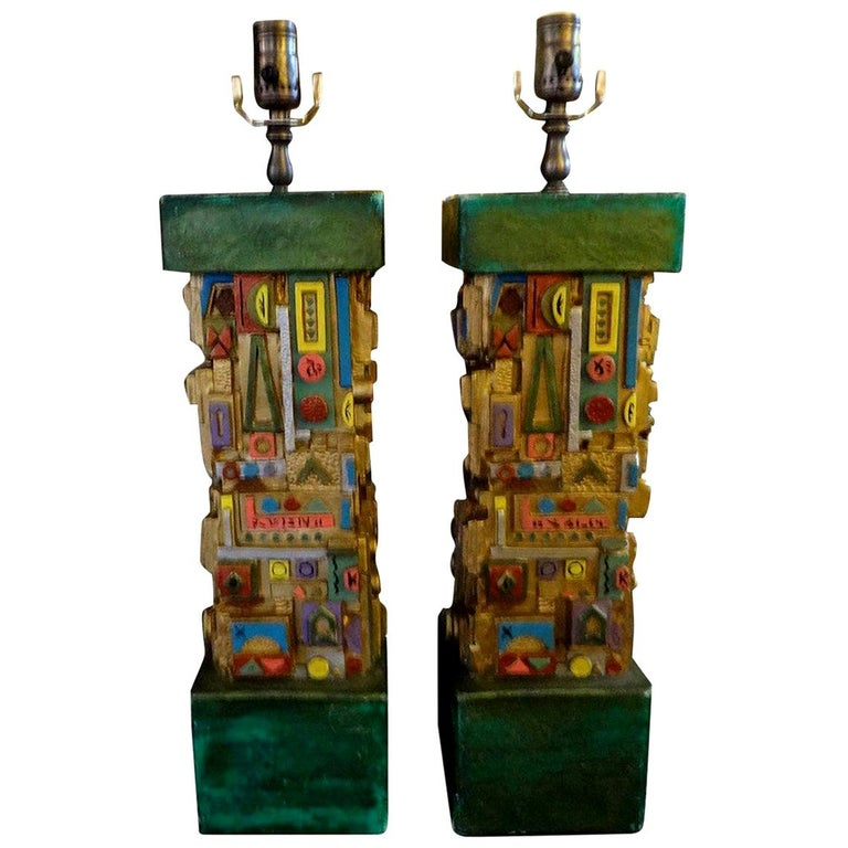 Most unusual pair of Mid-Century Modern colorful plaster lamps in the manner of Louise Nevelson. These beautifully colored midcentury lamps have been newly wired to U.S. specifications.