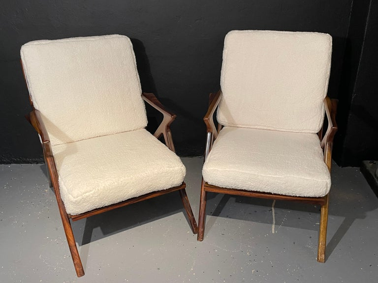 Pair of wooden slat back and seat Mid-Century Modern rosewood or walnut armchairs having been newly upholstered in a plush Sherpa fabric and fully restored so they are ready to sit in any room and make a statement. The thick strong Z-form sides